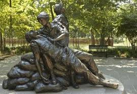 Vietnam war memorial with nurse and wounded soldier.
