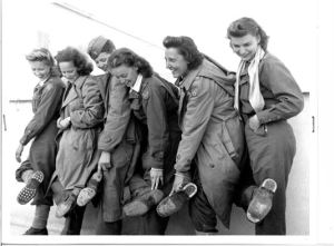 Nurses showing worn out heels after a sixty day hike out of enemy territory!